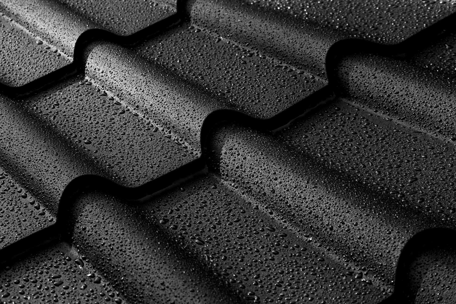 black roof tiles with water drops