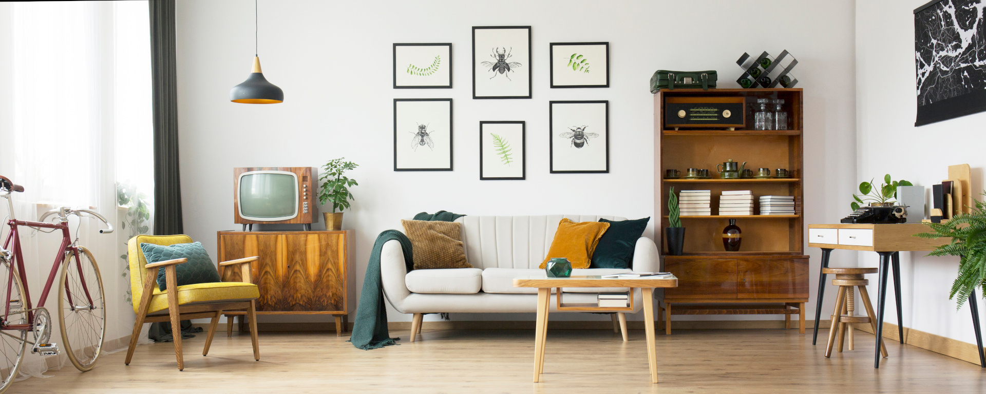 Living room with furniture and cycle