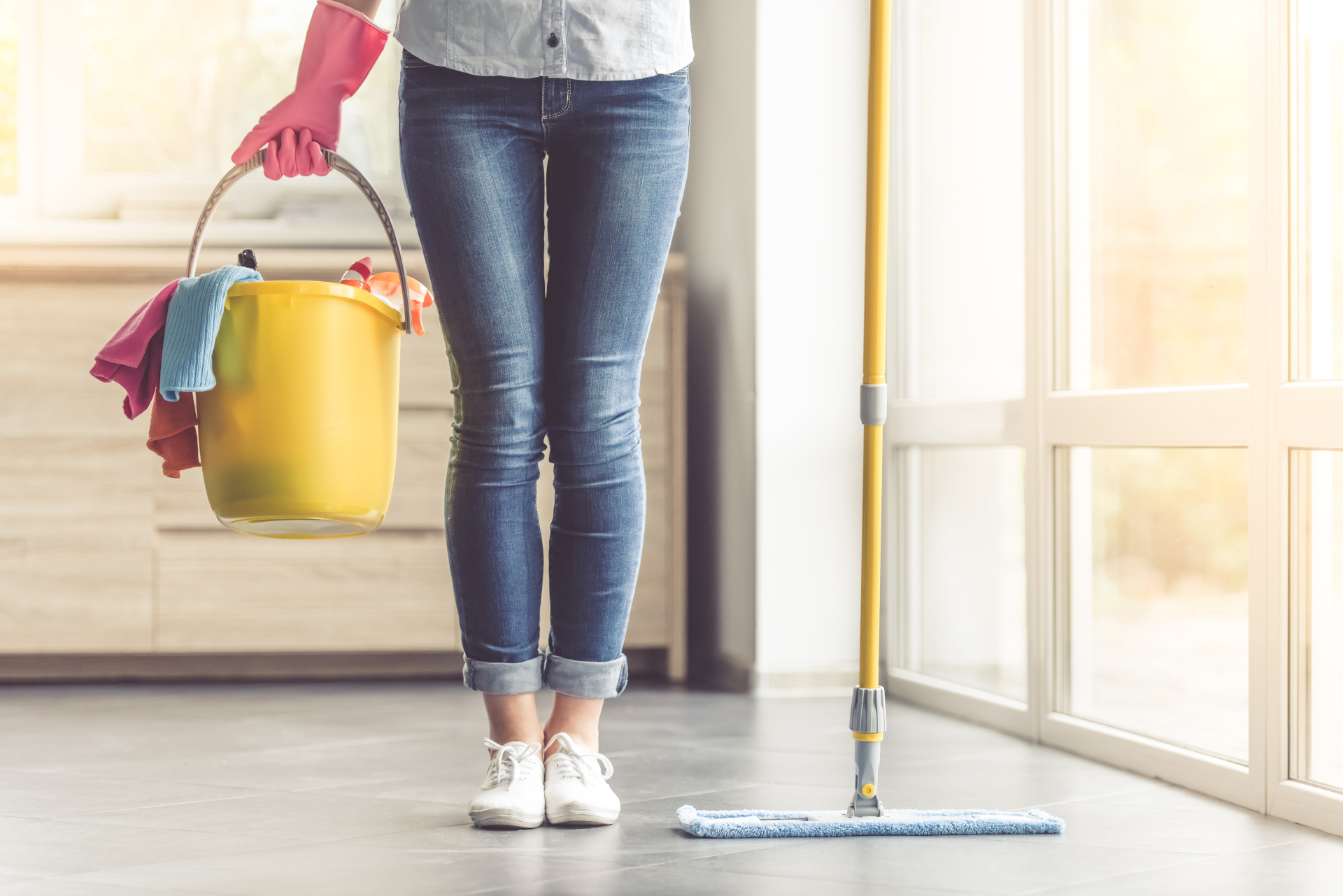 Lady ready with all tools to clean the home