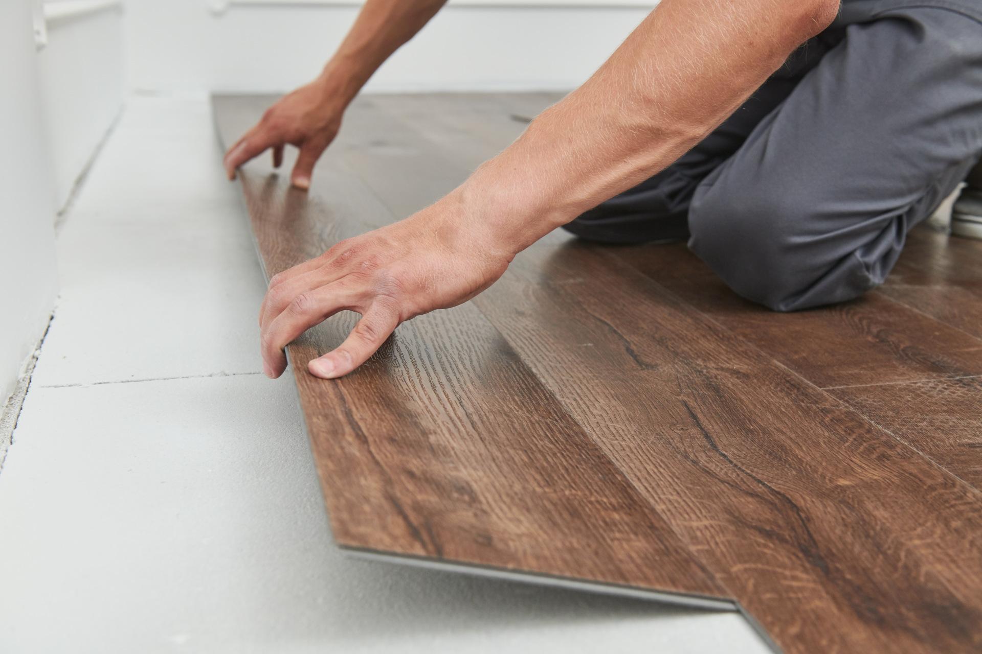 Flooring person putting timber laminate