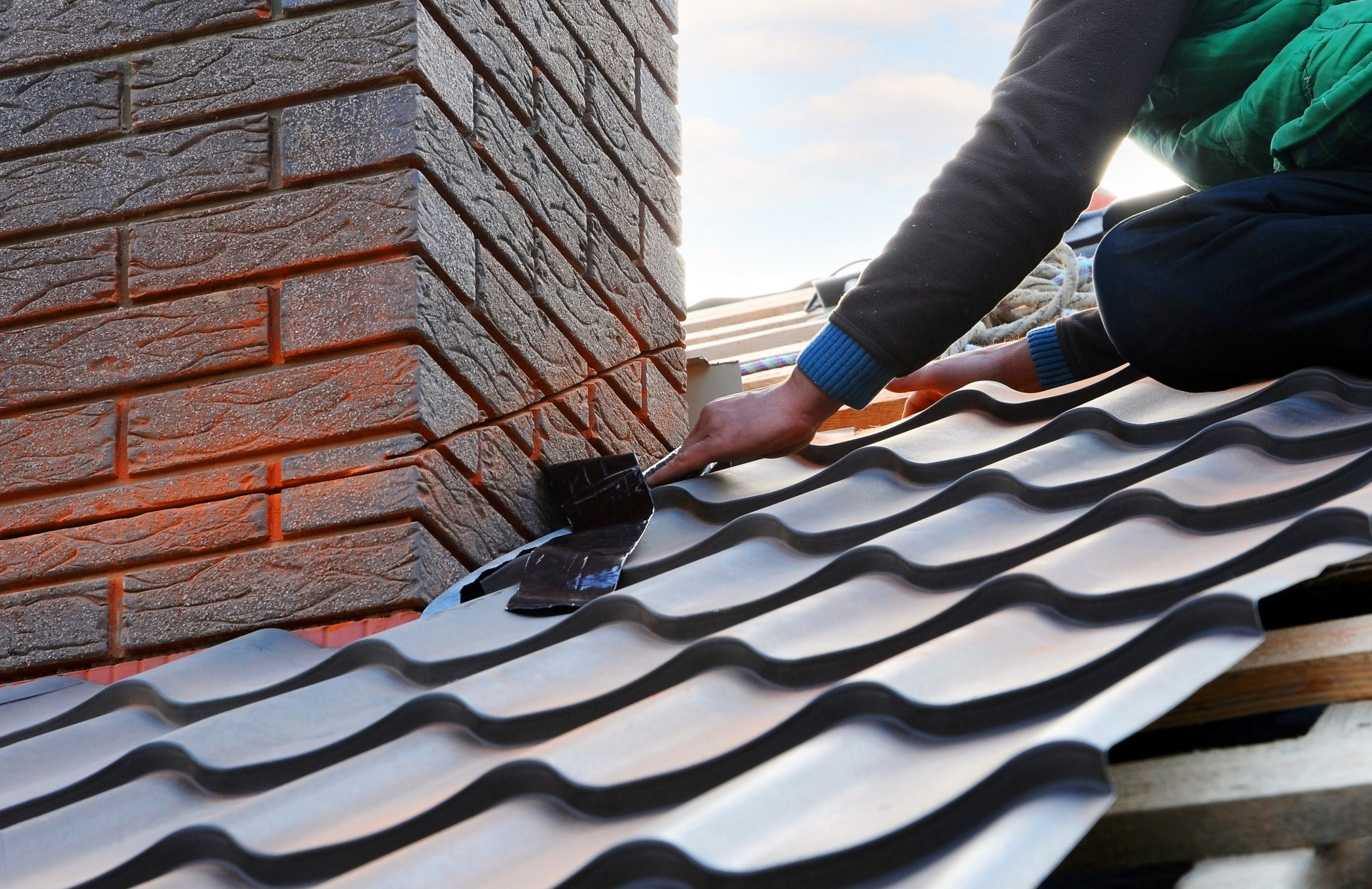 Roofing contractor fixing a roof